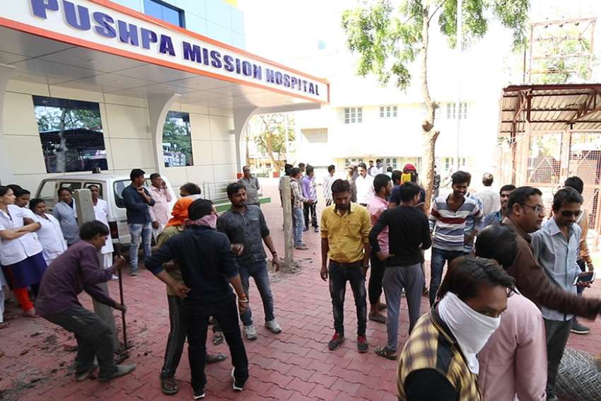 Suspected Hindu activists put up a fence blocking the emergency entrance of Pushpa Mission Hospital in Ujjain, India, after destroying the Catholic hospital's wall March 12.