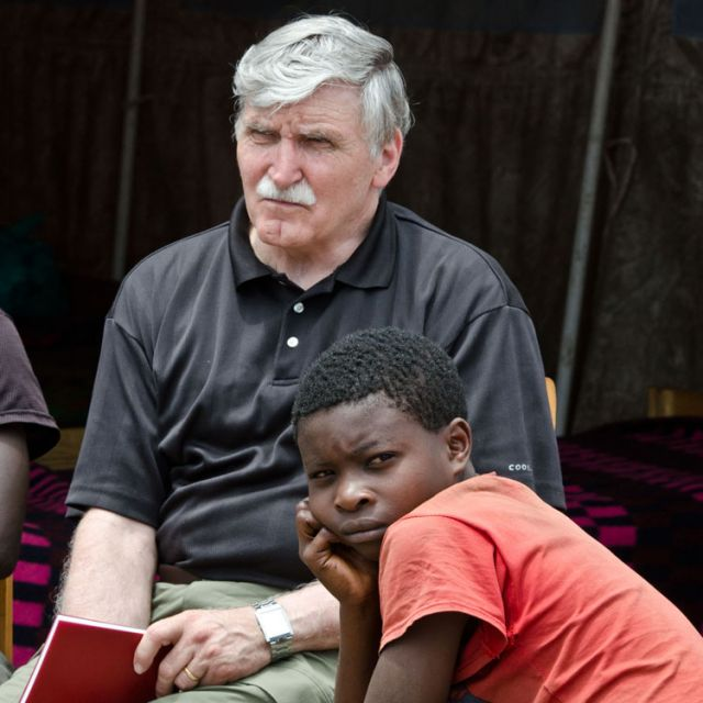 Senator Roméo Dallaire with Bwira Kapoto, a former child soldier, at the UN transit camp for ex-combatants in Goma, Congo.