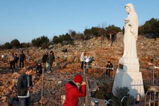 Pilgrims pray in front of a statue of Mary in 2011 on Apparition Hill in Medjugorje, Bosnia-Herzegovina. The Pope appointed Archbishop Henryk Hoser, the retired archbishop of Warsaw-Praga, Poland, to be apostolic visitor to Medjugorje.
