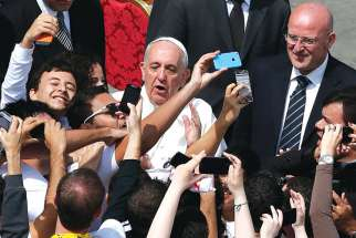 Pope Francis, pictured above being mobbed by youth from Brazil and Poland in St. Peter's Square, is popular with young Catholics. Ontario's Catholic secondary school students have launched a campaign to request the pontiff participate in their province-wide Mass.