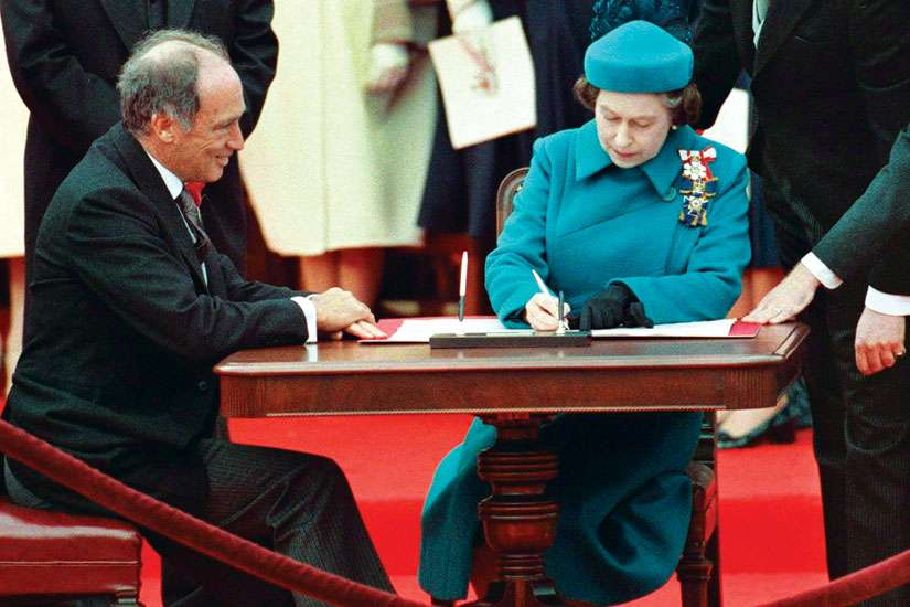 Queen Elizabeth II signs the Canadian Charter of Rights and Freedoms in 1982 as then prime minister Pierre Trudeau looks on. Pro-euthanasia forces have used Canada's Charter to portray opposition to euthanasia as being opposed to human rights.