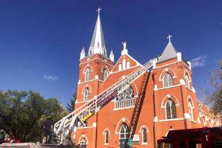 Firefighters respond to an Aug. 30 fire at Sacred Heart Church of the First Peoples in Edmonton. No one was injured in the blaze and the cause is under investigation.