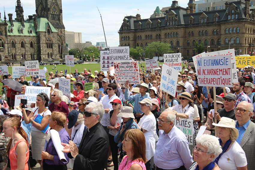 Opponents of euthanasia and assisted suicide rally on Parliament Hill in Ottawa, Ontario, in early June 2016. Medical ethicist Fr. Mark Miller recommends adding a line about rejecting the suicide option, just in case.