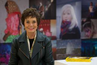 Maureen Orth poses for a photo at National Geographic's building in Washington Nov. 24. Orth visited several countries and interviewed dozens of people with strong devotional ties to Mary -- from those who claim to have seen her to those who believe Mary's intercession has healed them and those who simply seek her spiritual guidance.