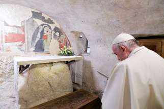 Pope Francis prays during a visit to the Nativity scene of Greccio, Italy, Dec. 1, 2019. The first Nativity scene was assembled in Greccio by St. Francis of Assisi in 1223.