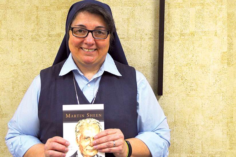 Film critic Sr. Rose Pacatte with her new book on Martin Sheen.