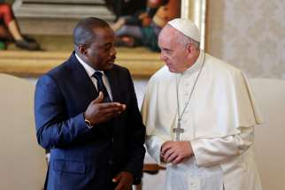 Pope Francis talks with Congolese President Joseph Kabila during a private audience at the Vatican Sept. 26.
