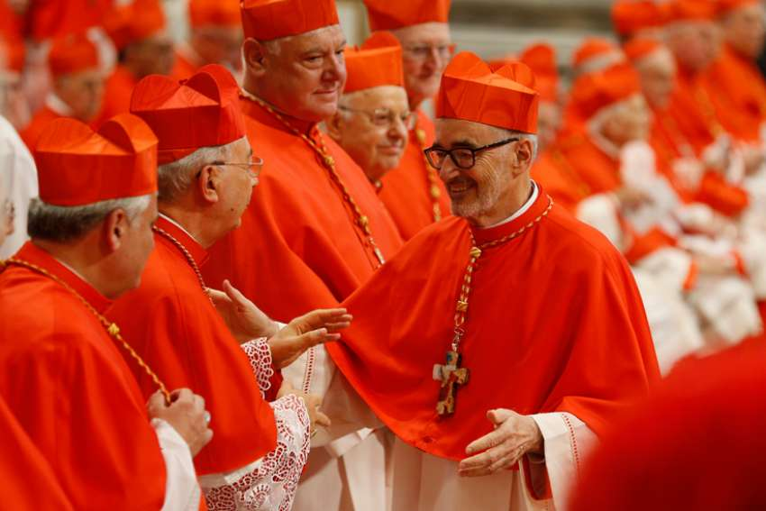 New Canadian Cardinal Michael Czerny greets French Cardinal Dominique Mamberti during a consistory led by Pope Francis for the creation of 13 new cardinals in St. Peter's Basilica at the Vatican Oct. 5, 2019.