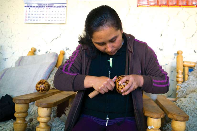 An artisan from Manos Amigas in Lima, Peru, creates an ornament that will be sold through fair trade retailer Ten Thousand Villages.