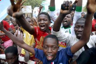 Supporters of presidential candidate Muhammadu Buhari and his All Progressives Congress (APC) party celebrate in Kano on Tuesday (March 31, 2015). Three decades after seizing power in a military coup, Buhari became the first Nigerian to oust a president through the ballot box, putting him in charge of Africa's biggest economy and one of its most turbulent democracies.
