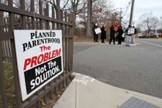 Pro-life advocates participate in a prayer vigil in January near the entrance to a Planned Parenthood clinic in Smithtown, N.Y., that performs abortions. An AP survey shows that the number of abortions has declined in most states.