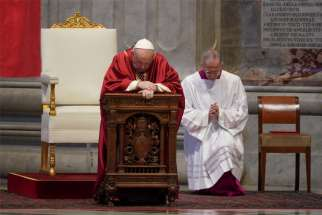 Pope Francis prays as he leads the Good Friday Liturgy of the Lord's Passion April 10, 2020, at the Altar of the Chair in St. Peter's Basilica at the Vatican.