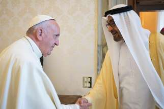 "Pope Francis shakes hands with Mohammed bin Zayed bin Sultan Al-Nahyan, crown prince of Abu Dhabi. The Pope will ""participate in the International Interfaith Meeting on 'Human Fraternity'"" after receiving an invitation by the crown prince."
