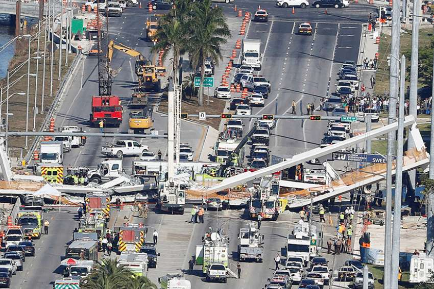An aerial view shows a pedestrian bridge that collapsed March 15 at Florida International University in Miami. Authorities in Florida's Miami-Dade area said at least six people have died but the number could rise as they search through the rubble.