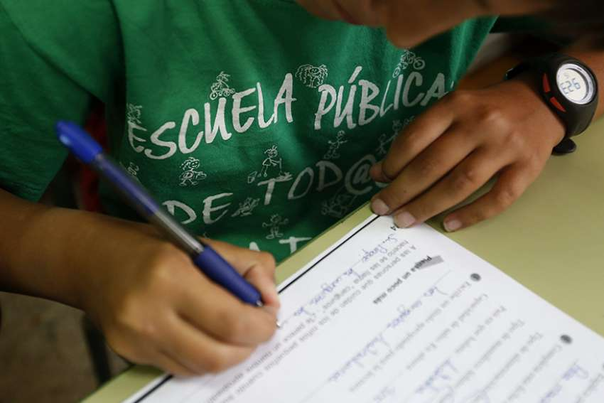 "A student fills a school exercise at Joaquin Costa public school in Madrid. Spain's Catholic Church has voiced ""deep concern"" over plans by the government to curb religious teaching and re-examine past accords with the Vatican."