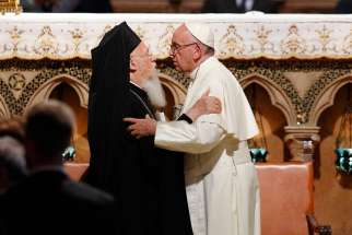 Pope Francis and Ecumenical Patriarch Bartholomew of Constantinople at  Assisi, Italy, Sept. 20. Texts by Pope Francis and retired Pope Benedict were published in anticipation of the 25th anniversary of Patriarch Bartholomew's election.