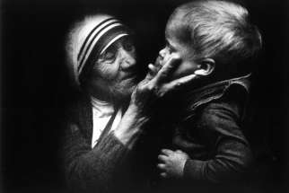An undated file picture shows Blessed Teresa of Kolkata holding a child during a visit to Warsaw, Poland. Mother Teresa will be canonized by Pope Francis Sept. 4 at the Vatican.