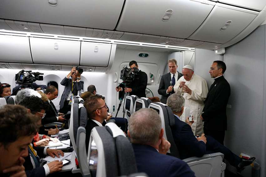Pope Francis answers questions from journalists aboard his flight from Cartagena, Colombia, to Rome Sept. 10.