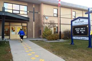 Entrance of St. Joseph Elementary Junior High School in Calgary 2015. A former principal from 2015-2017 of the school has filed has filed two human rights complaints charging that the school district refused her employment on the grounds of marital status, religious beliefs, and sexual orientation.