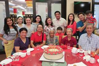 The Tsoi-Ko Din family celebrate grandmother Concepcion Ko Din's 90th birthday.