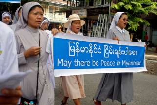 "Nuns carry a banner reading ""May there be peace in Myanmar"" during an Oct. 22 protest in Myitkyina in opposition to the country's civil war. Retired Archbishop Paul Zinghtung Grawng of Mandalay said the Kachin people are ""very fearful"" and have ""little hope of peace"" any time soon."
