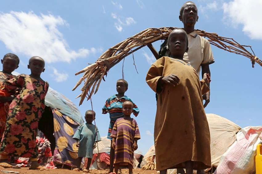 Internally displaced Somali people are seen outside their shelter after fleeing from drought-stricken regions at a makeshift camp in Baidoa, west of Somalia's capital of Mogadishu, on March 26, 2017.