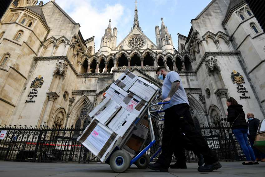 Officials deliver legal documents to the High Court in London Nov. 2, 2020. Bishop Philip Egan of Portsmouth and Catholic doctors welcomed the court ruling stopping children from accessing sex-change therapies.