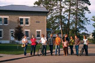 Students from Our Lady Seat of Wisdom Academy pass by St. Joseph Hall on the campus in Barry's Bay, Ont.