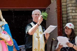 Bishop John Pazak giving a blessing in front of Our Lady of Mount Carmel Church in Toronto, May 29, 2016. the Holy Protection of Mary Byzantine Eparchy of Phoenix officially celebrated the enthronement of Bishop John S. Pazak on July 20.
