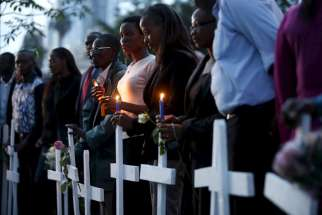 People attend a memorial vigil in Nairobi, Kenya, April 7, for the 147 people killed in an attack on Garissa University College. Kenyan bishops are urging the government to step up security and for citizens to remain united after al-Shabab militants atta cked the college campus April 2.