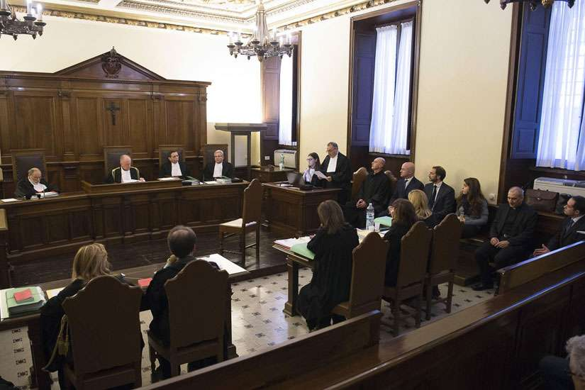 The opening proceedings for the 'VatiLeaks' case are seen in a Vatican courtroom Nov. 24. All five people accused of involvement in leaking and publishing confidential documents about Vatican finances were present at the opening of the criminal trial in a Vatican courtroom.