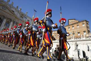 Swiss Guards march in St. Peter's Square at the Vatican. To better protect minors and vulnerable adults from all forms of abuse and exploitation, Pope Francis approved a new law and a set of safeguarding guidelines for Vatican City State and the Roman Curia.