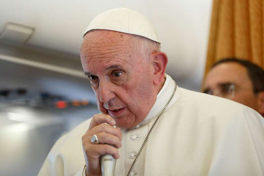 Pope Francis answers questions from journalists aboard his flight from Malmo, Sweden, to Rome Nov. 1.