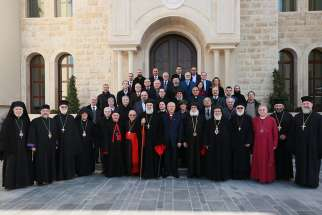 Members of the executive committee of the Middle East Council of Churches pose for a group photo during their Jan. 22-23 meeting in Atchaneh, Lebanon.