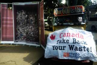 Environmental activist group Ban Toxics displays an image of a container of trash from Canada a few kilometers from where Prime Minister Justin Trudeau is attending the ASEAN summit on Nov. 14.