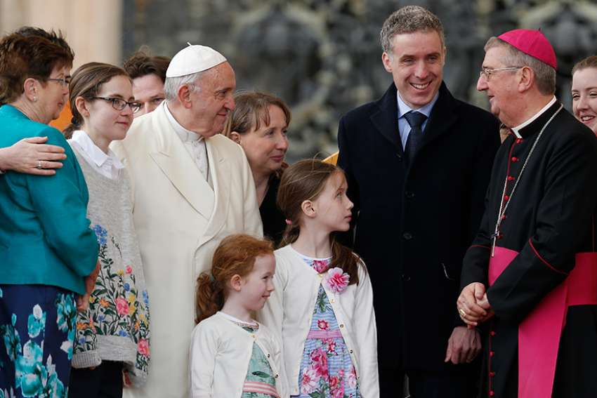 Pope Francis talks with Archbishop Diarmuid Martin of Dublin as he meets an Irish delegation of families during his general audience in St. Peter's Square at the Vatican March 21.