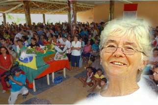 Sister Dorothy Stang is seen on the right. In this Feb. 15, 2005, file photo (background), inhabitants of Anapu, Brazil, gather for a Mass to honor U.S.-born Sr. Dorothy Stang, a member of the Sisters of Notre Dame de Namur who was murdered by ranchers three days earlier. In the 10 years since her murder, land reform risks have not decreased, said one of the coordinators of the Brazilian bishops' Pastoral Land Commission.