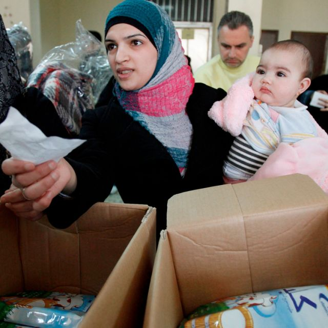 Syrian refugees receive humanitarian aid from an Islamic organization in Tripoli, Lebanon, March 6. As temperatures drop to near freezing in Lebanon, Caritas is working to find shelter for Syrian refugees, mostly women and children.