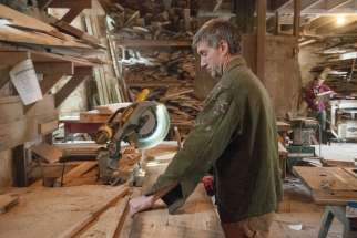 Woodworker Michael Schmiedicke works in his Strong Oaks Woodshop April 29 in Front Royal, Va. Schmiedicke, a parishioner of St. John the Baptist Church in Front Royal, builds caskets out of reclaimed lumber from the Shenandoah Valley.