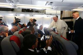 Pope Francis answers questions from journalists aboard his flight from Antananarivo, Madagascar, to Rome Sept. 10, 2019.