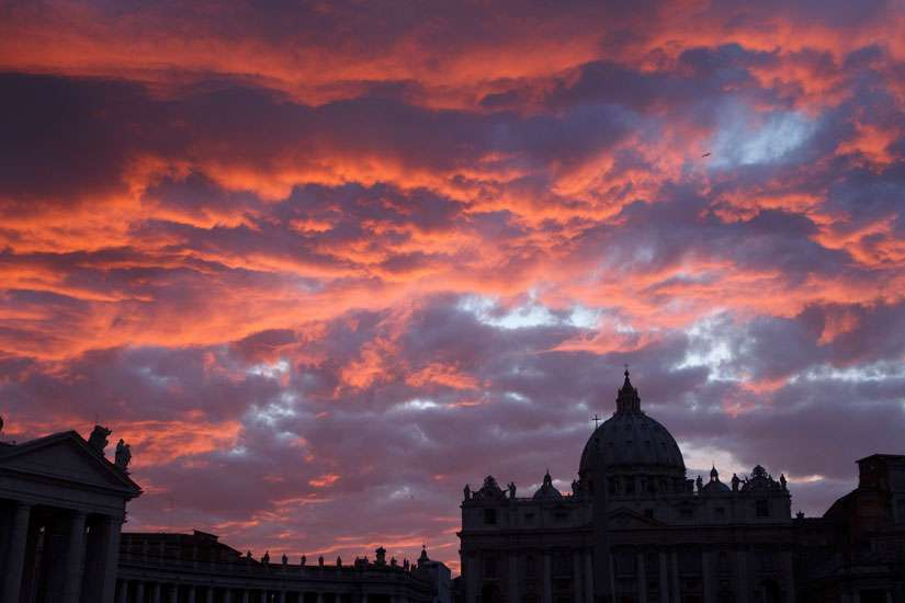 St. Peter's Basilica is seen during sunset in Rome in this Oct. 20, 2011, file photo. Pope Francis has approved revised norms for the Congregation for Saints' Causes regarding medical consultations on healings alleged to be miracles.
