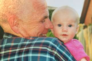Baby Abigail with her grandfather.