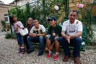 Syrian refugees Ramy and Suhila and their children, Khodus, Rashid and Abdul Mejid, relax in Rome in 2016 after Pope Francis brought them with him from a refugee camp in Lesbos, Greece.