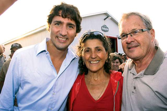 MP Laurence MacAulay, right, with Liberal leader Justin Trudeau and a constituent.