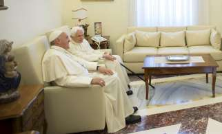Pope Francis chats with retired Pope Benedict XVI during a meeting at the Vatican June 30.
