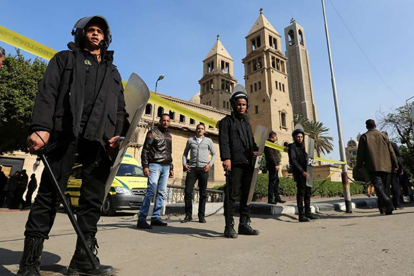 Members of the special police forces stand guard to secure the area around the Coptic Orthodox cathedral complex Dec. 11 after an explosion inside the complex in Cairo. St. Mark's Cathedral has since been restored.