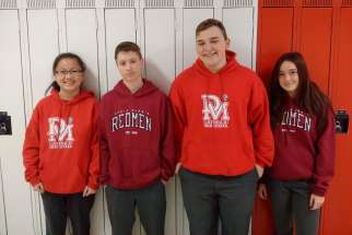 Some students from Denis Morris Catholic High School are allowed to continue wearing Redmen sweats, shirts and jerseys for the next four years during a transition period as the school changes its team name to Reds.