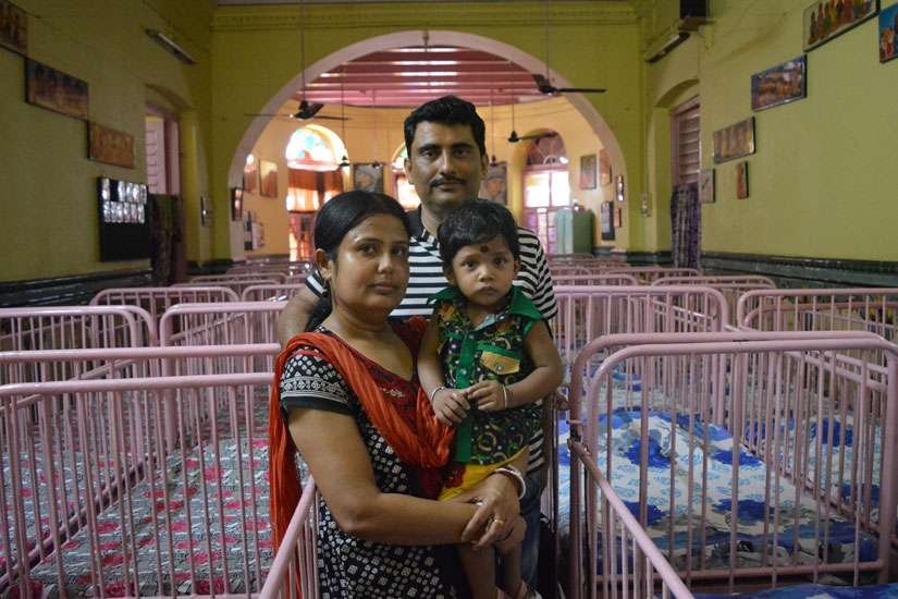 "Anirban Mukherjee and his wife, Sampa, pose May 2 with their 17-month-old son Anirban at Shishu Bhavan, the Missionaries of Charity children's home in Kolkata, India. The parents adopted Anirban from the home in April 2015 and call him ""the gift from the saint of Kolkata, Mother Teresa."""