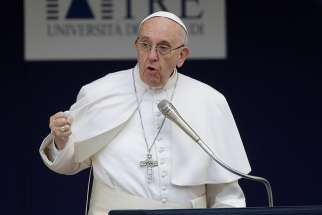 Pope Francis gestures as he talks during a Feb. 17 meeting at Roma Tre University.