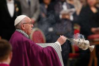 Pope Francis uses incense during a Lenten penance service in St. Peter's Basilica at the Vatican March 17.